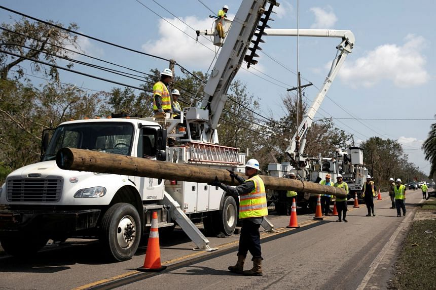 Power restoration workers are seen in the aftermath of Hurricane Ida, in Jean Lafitte, Louisiana, on Sept 2, 2021.
