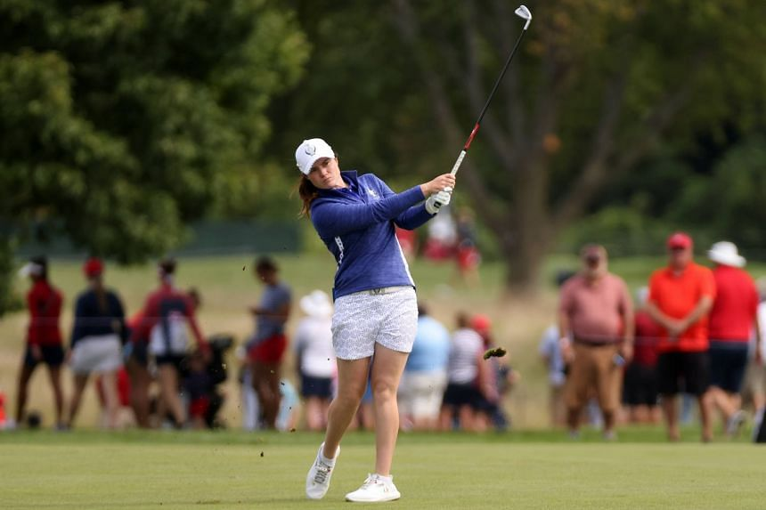 Leona Maguire of Team Europe plays her shot on the 16th hole during the first round of the Solheim Cup.