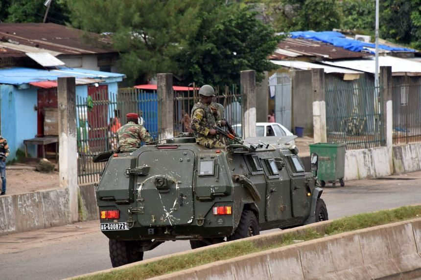 Members of the Armed Forces of Guinea drive through the central neighbourhood of Kaloum in Conakry on Sept 5, 2021.