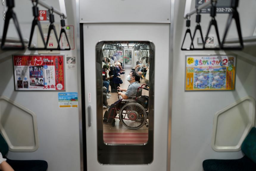 Yuto Hirano, a volunteer for the Paralympics, on the subway in Tokyo, on Aug 23, 2021.