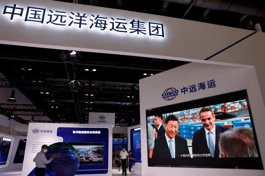 A screen displays video footage of Chinese President Xi Jinping's visit to a port in Greece, at the Cosco Shipping booth during the 2021 China International Fair for Trade in Services (CIFTIS) in Beijing, China on Sept 4, 2021.