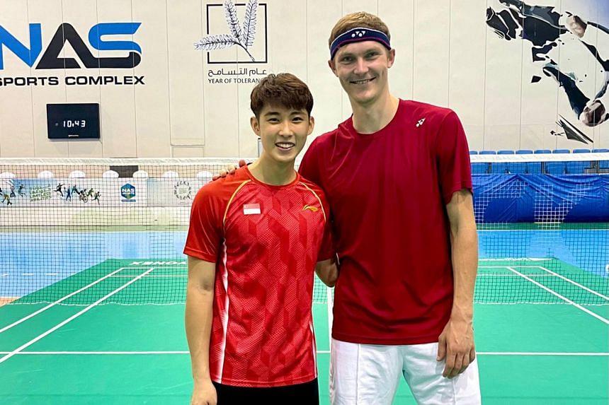 Singapore shuttler Loh Kean Yew (left) with world No. 2 Viktor Axelsen.