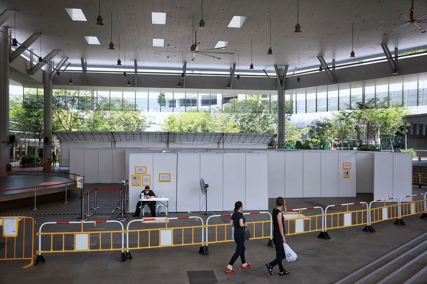 A quick test centre for those who have been issued a health risk warning, next to Bedok Interchange Hawker Centre on July 18, 2021.