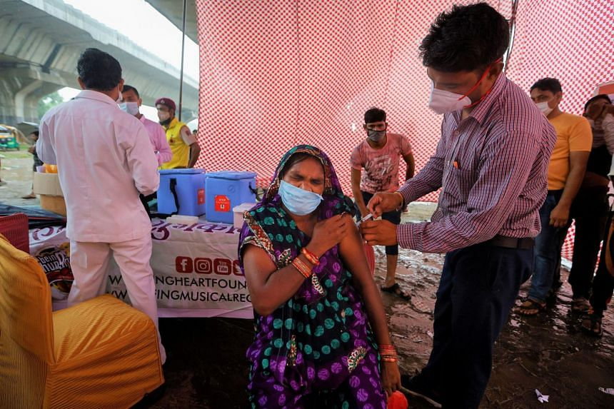 A woman receiving a dose of the Covaxin Covid-19 vaaccine during a vaccination drive in New Delhi on Aug 31, 2021.