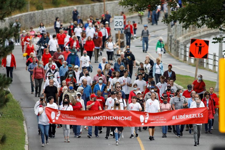 Supporters of Michael Kovrig and Michael Spavor march during a protest in Ottawa on Sept 5, 2021.