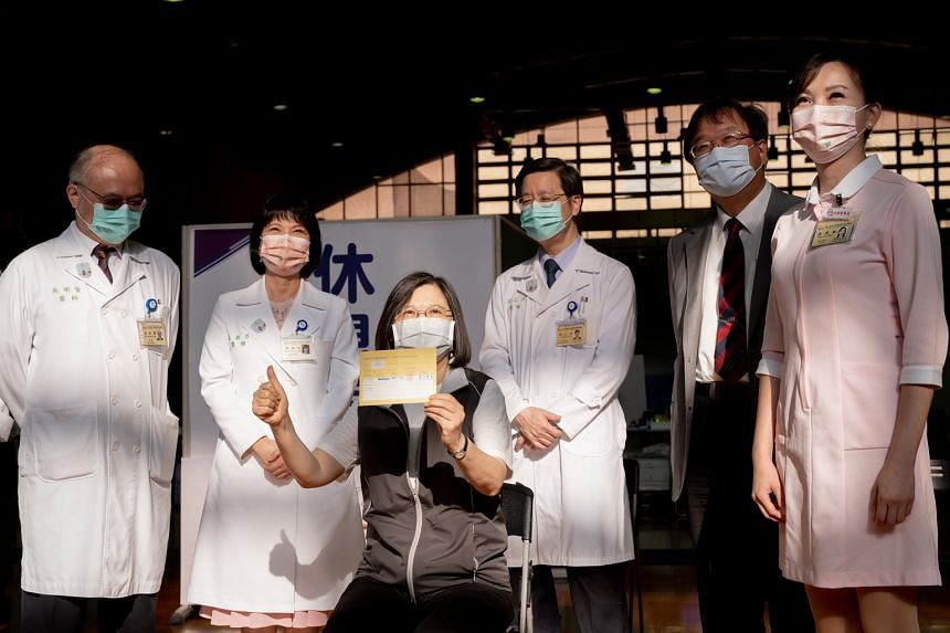 Taiwanese President Tsai Ing-wen displaying her vaccination card after receiving a Covid-19 vaccine produced by Medigen Vaccine Biologics in Taipei on Aug 23, 2021.