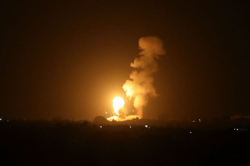 A fireball rises following an air strike in Khan Yunis in the southern Gaza Strip, late on Sept 6, 2021.