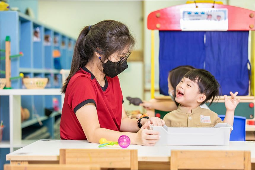 Senior teacher Lee Wei Ling with a pupil at Kindle Garden. Set up by social service agency Awwa in 2016, it is the first inclusive pre-school here.