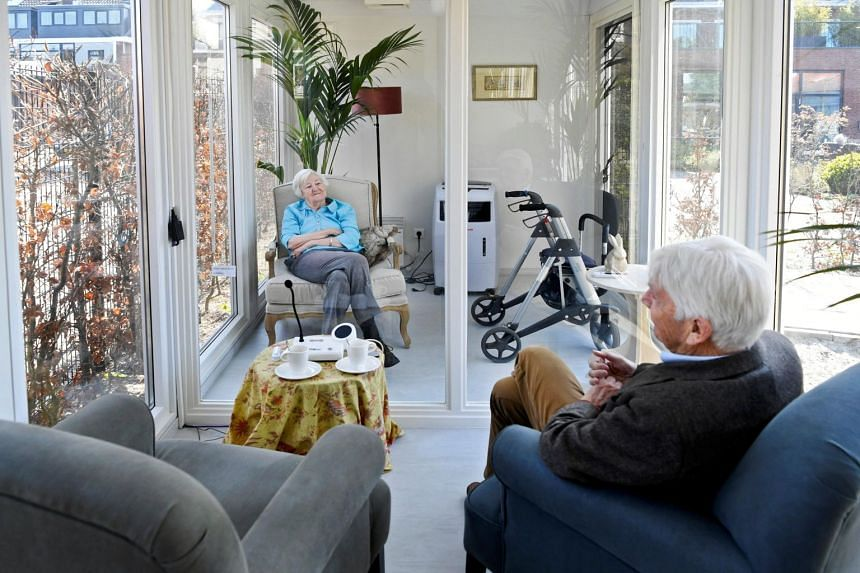 A man visits his wife at a care facility for elderly people with dementia in Wassenaar, Netherlands on April 9, 2020.