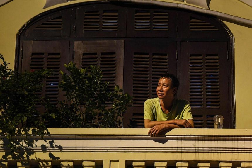 A man having a drink on the balcony of his home in Hanoi, during the government-imposed lockdown, on Sept 2, 2021.