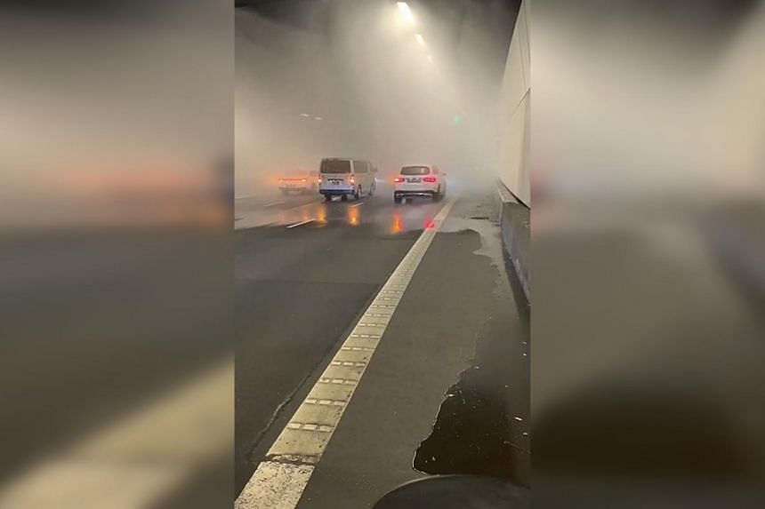 Videos showing water spraying on vehicles were circulating on social media platforms with traffic congestion at the exit.