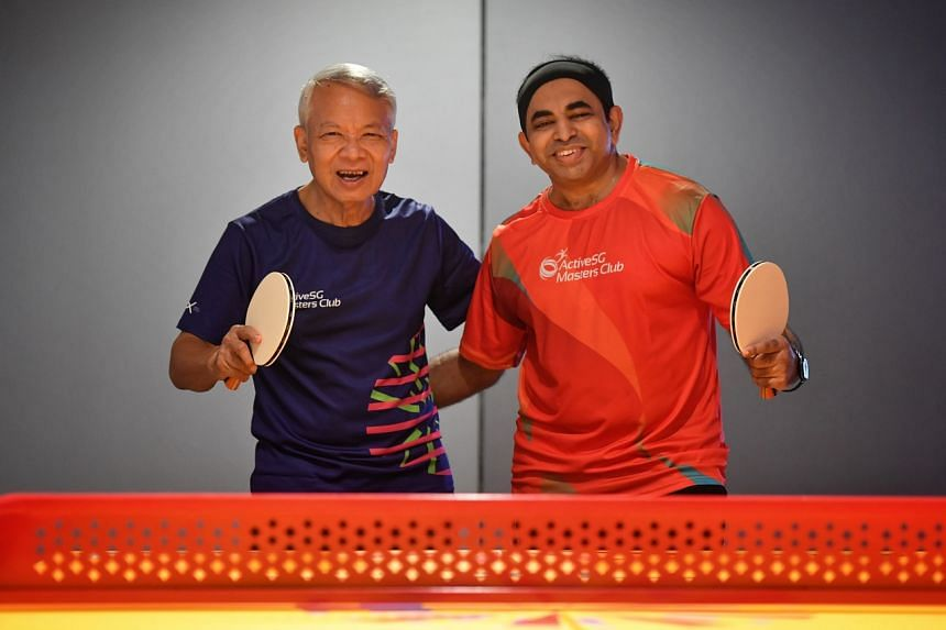 Tony Lui (left) and Sunil Raghavan playing table tennis at Our Tampines Hub on Aug 31, 2021.