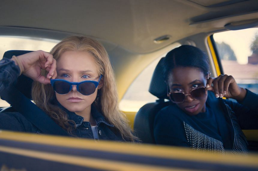 Still from the film Queenpins starring Kristen Bell (left) and Kirby Howell-Baptiste.