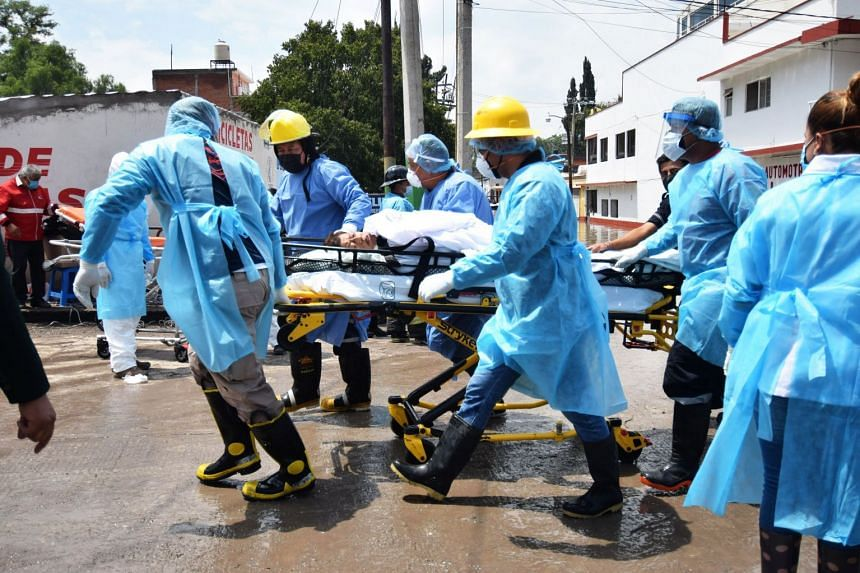 Medical staff move a patient of the IMSS Hospital in Tula de Allende, Hidalgo state, Mexico, on Sept 7, 2021.