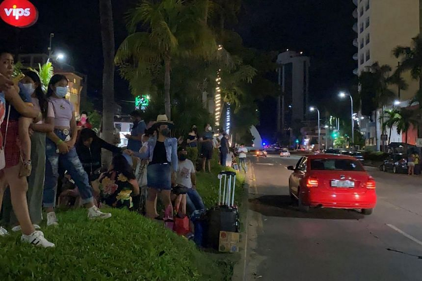 Tourists outside a hotel after a quake in Acapulco, Guerrero state, Mexico on Sept 7, 2021.