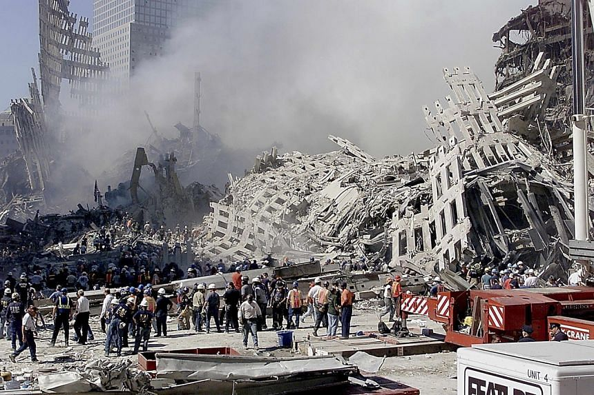 In a photo from Sept 13, 2001, fire and rescue workers search through the rubble of the World Trade Centre in New York.