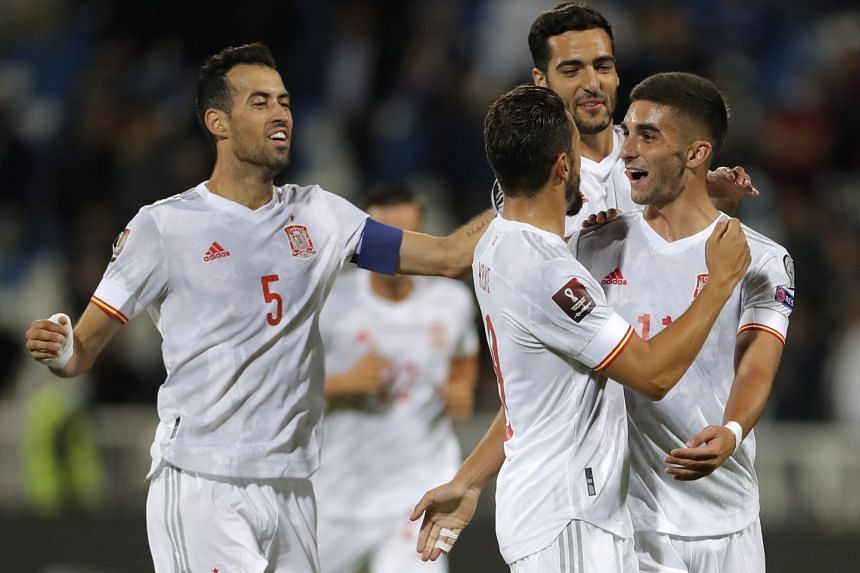 Ferran Torres celebrates with teammates after scoring Spain's second goal.