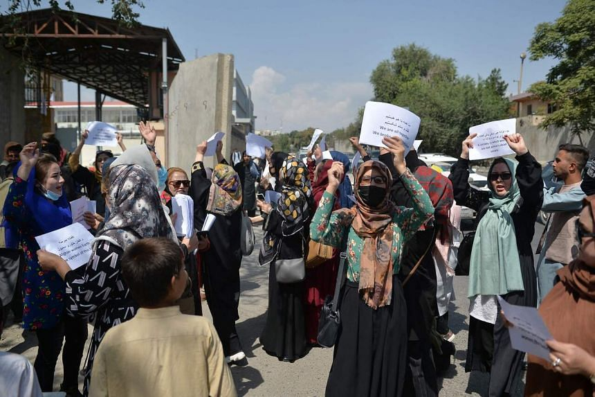 Afghan women take part in a protest march for their rights under Taliban rule in Kabul on Sept 3, 2021.