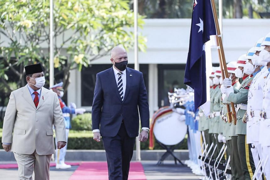Indonesian Defence Minister Prabowo Subianto and his Australian counterpart Peter Dutton inspecting the honour guards before their meeting in Jakarta on Sept 9, 2021.
