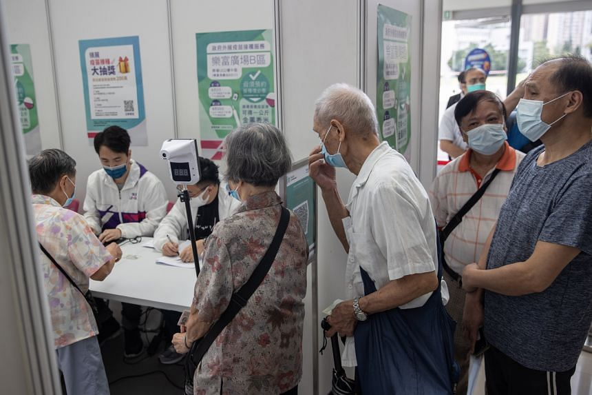 People queueing up to receive their Covid-19 vaccinations at a mall in Hong Kong on Sept 2, 2021.