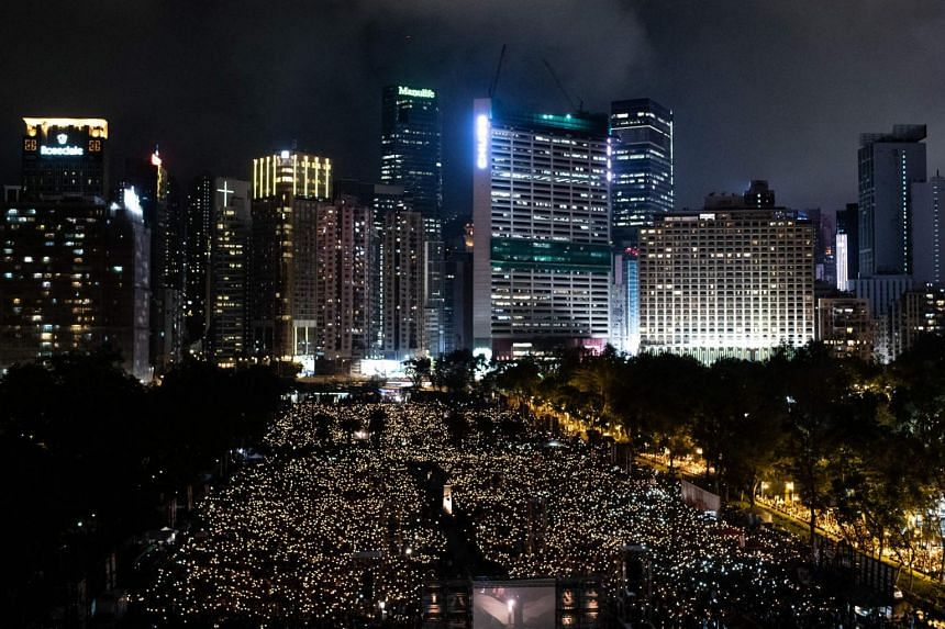 Thousands of activists defied a police ban to go ahead with the candlelight vigil in Victoria Park on the Tiananmen crackdown's 30th anniversary in 2019.