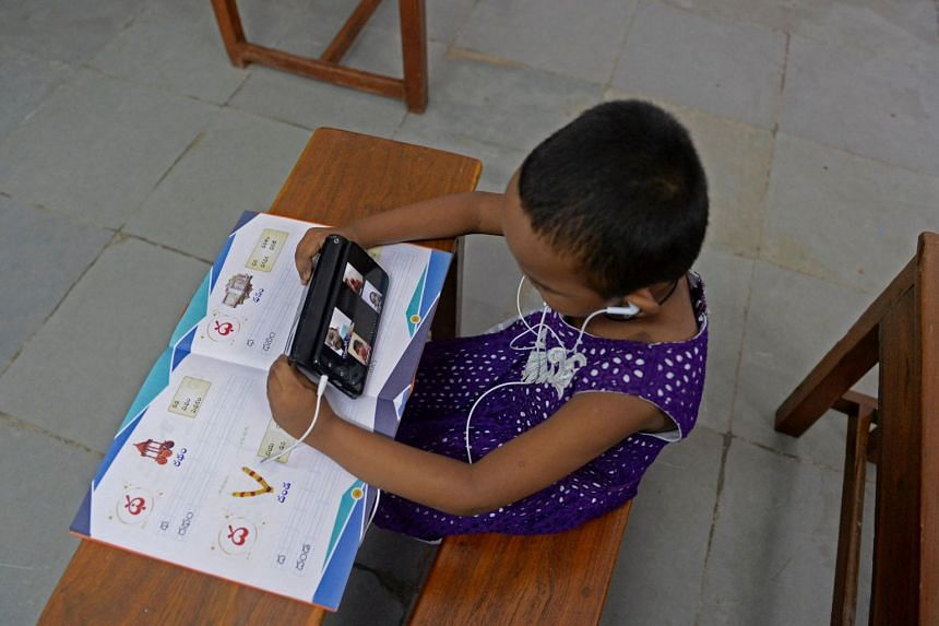 A child attends an online class in Hyderabad on July 8, 2021.