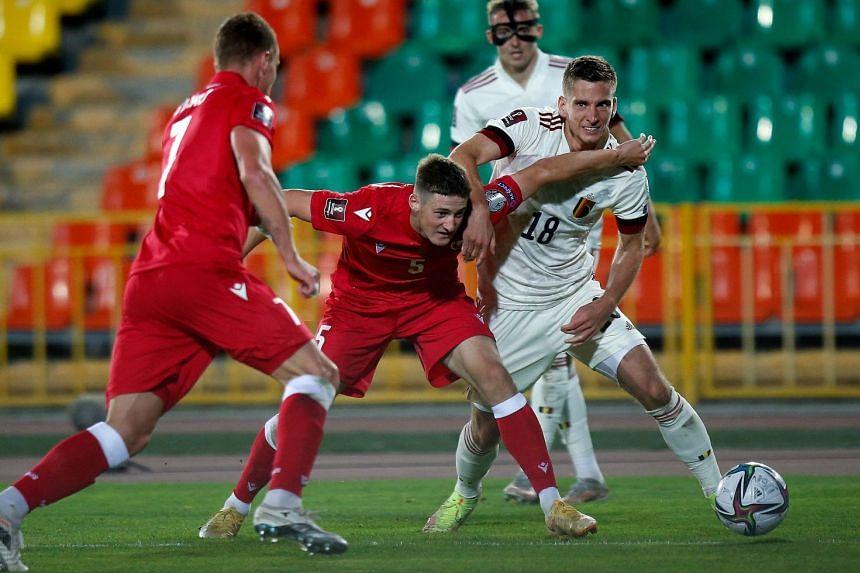 Belarus' Hleb Shauchenka and Belgium's midfielder Dennis Praet vie for the ball.
