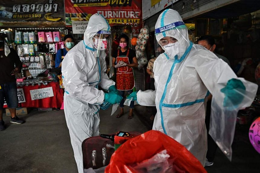 The research team from Chulalongkorn University's chemistry department collecting sweat samples from market vendors on Sept 8, 2021.