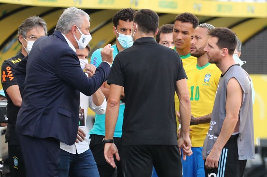Argentina's Lionel Messi (right) speaks with Brazil's Neymar Jr (second right) and coach Tite (left) after Brazilian health officials stopped a World Cup qualifier between Brazil and Argentina on Sept 5, 2021, over alleged Covid-19 breaches.