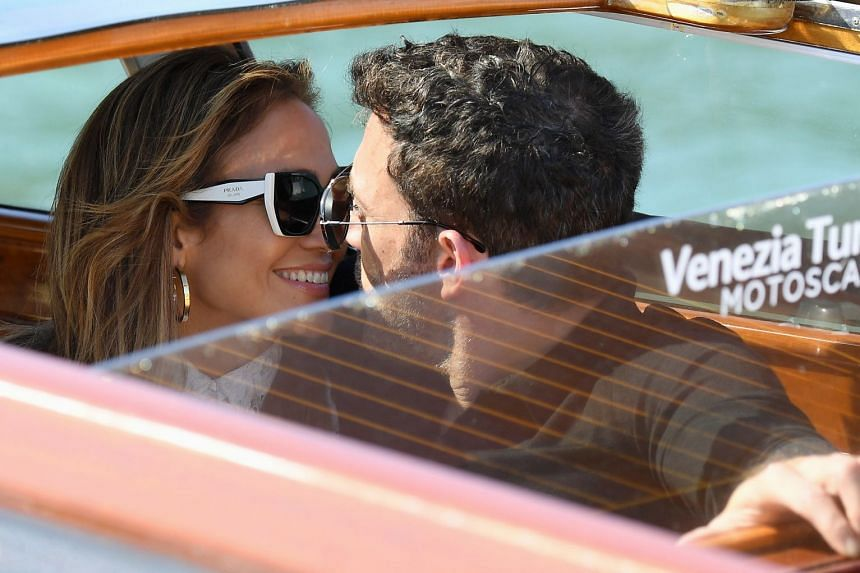 US actor Ben Affleck (right) and US actress and singer Jennifer Lopez sit in a watertaxi on their way to the Lido Beach as they arrive in Venice.