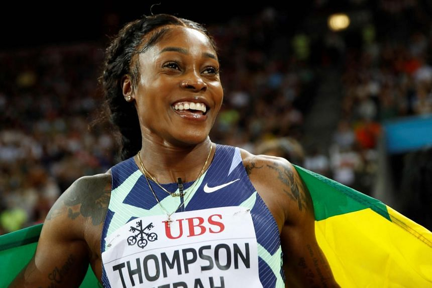 Jamaica's Elaine Thompson-Herah celebrates after winning the women's 100m event at the IAAF Diamond League athletics meeting in Zurich.