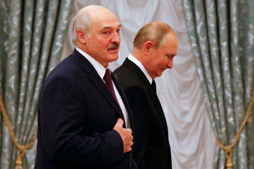 Russian President Vladimir Putin and his Belarusian counterpart Alexander Lukashenko attend a news conference following their talks at the Kremlin.