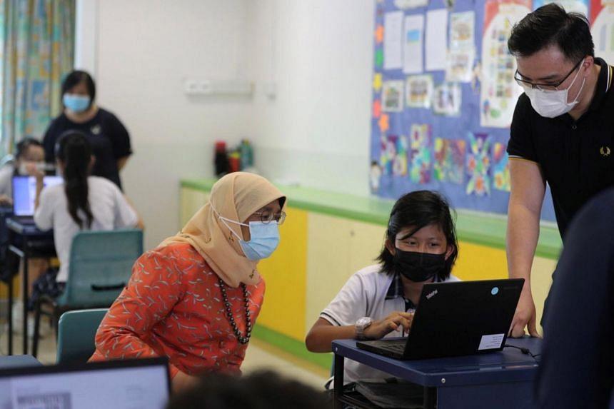 President Halimah Yacob observing a digital literacy workshop at Chua Chu Kang Primary School.