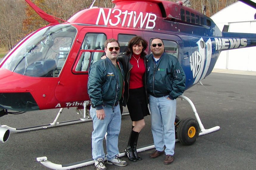 A 2001 photo of Melinda Murphy, aerial photographer Chet Wilson (left) and helicopter pilot Ray Rivera who covered the 9/11 attacks as a team.
