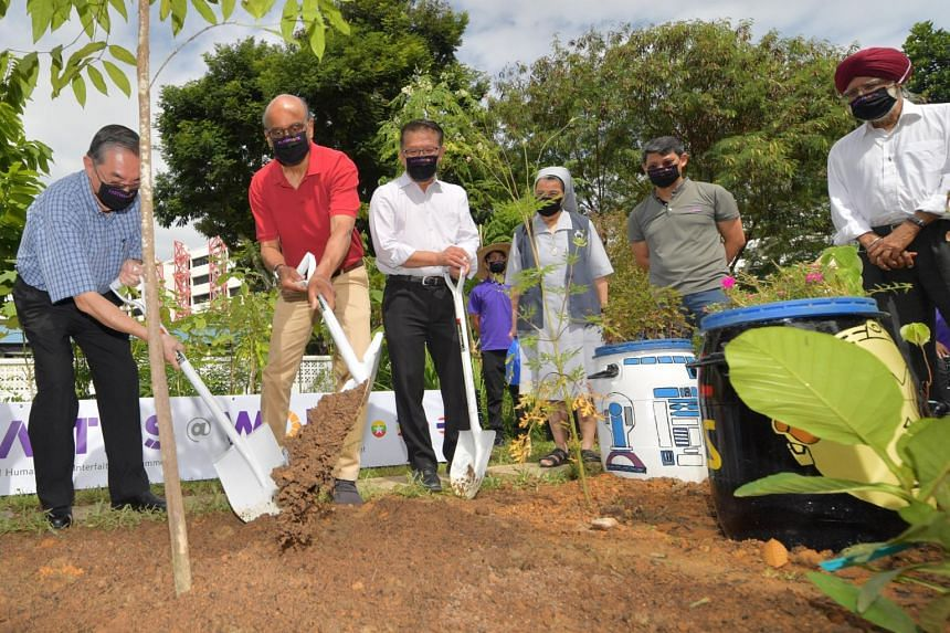 Senior Minister Tharman Shanmugaratnam (second from left) at the launch of the Faiths@Work Demo Farm at the Canossian School on Sept 10, 2021.