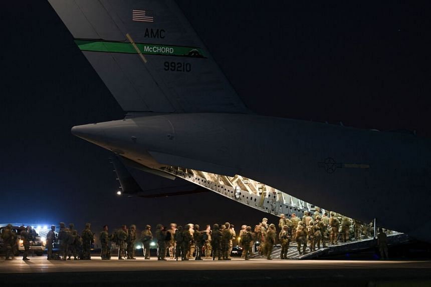 US Army soldiers board an aircraft in Kuwait on Aug 13, 2021, to support the relocation flights for at-risk Afghan allies and their families.