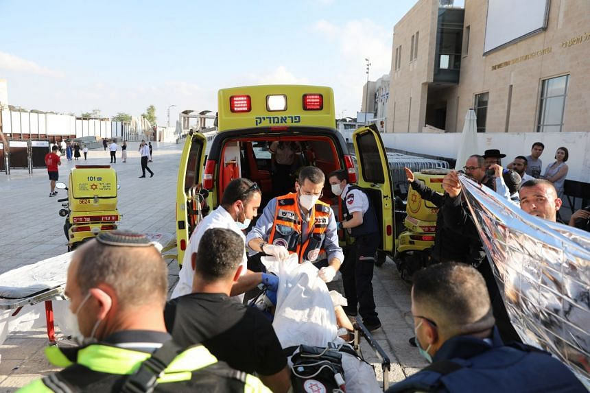 Emergency teams evacuate a wounded Palestinian man after a stabbing attack took place in the Old City of Jerusalem.