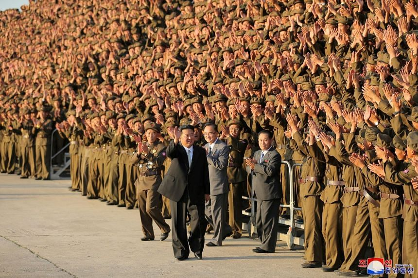 North Korean leader Kim Jong Un greets members of the military on the 73rd anniversary of the country's founding, in Pyongyang.