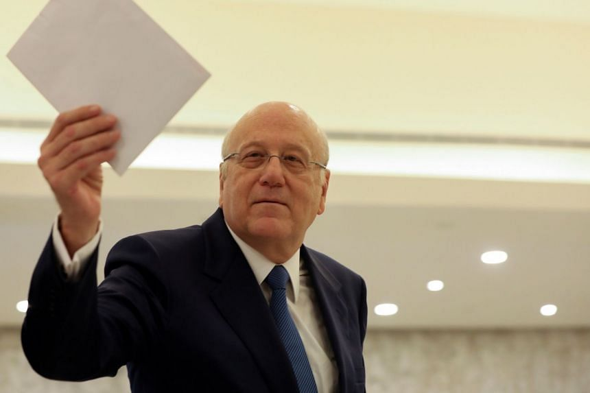 Lebanon PM Najib Mikati holds the Cabinet line up after a visit to the presidential palace on Sept 10, 2021.