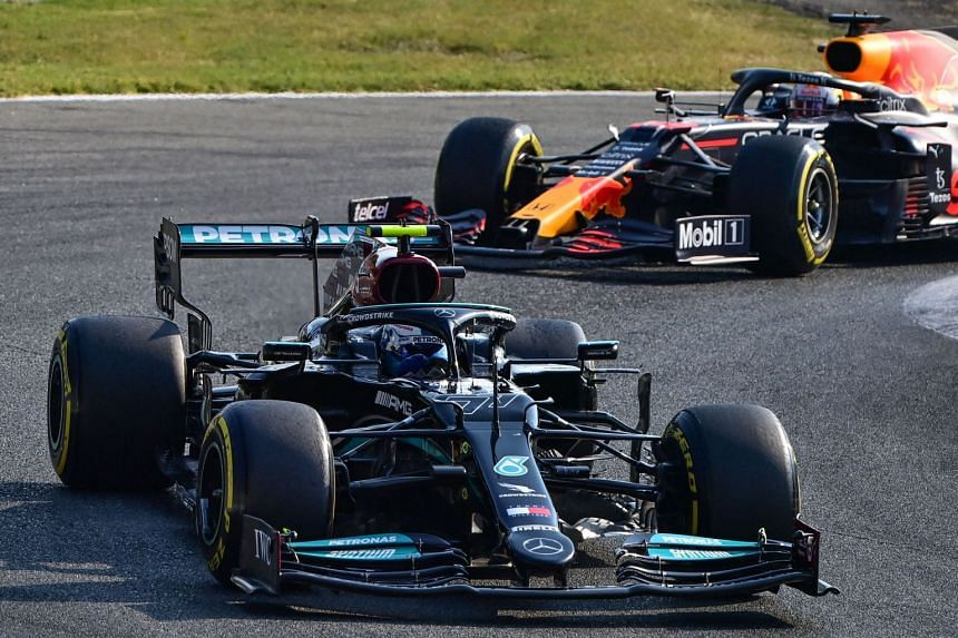 Mercedes' Valtteri Bottas drives ahead of Red Bull's Max Verstappen during the sprint session ahead of the Italian grand prix.