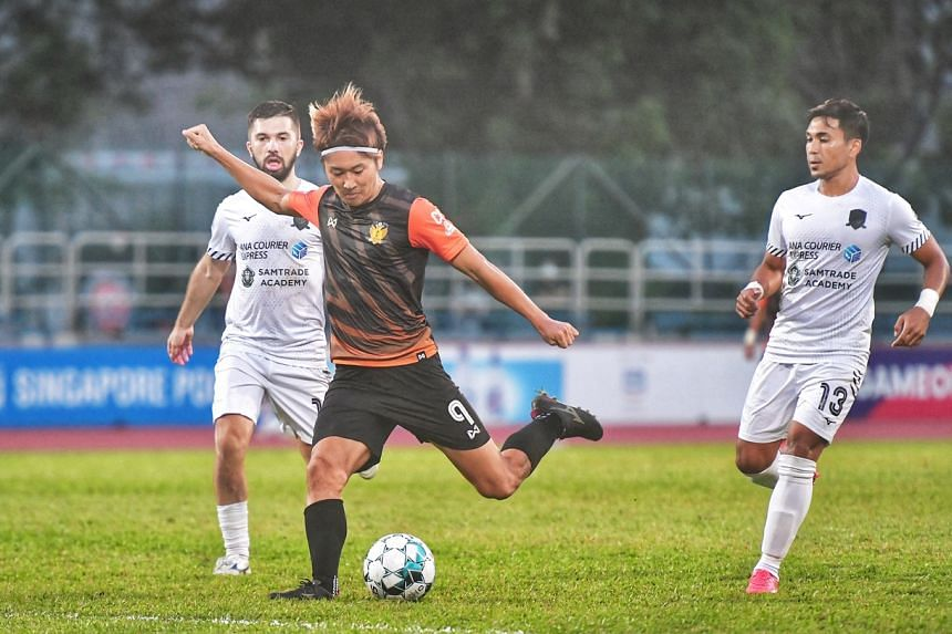Tomoyuki Doi (centre) leads the Singapore Premier League's scoring chart with 19 goals in 18 games.