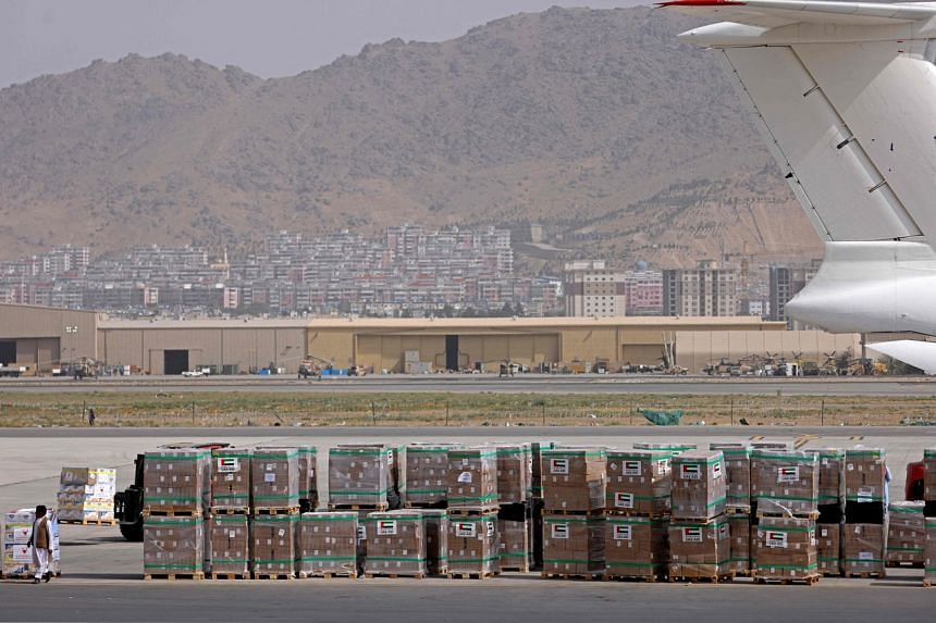 Aid packages from the United Arab Emirates arrive at the airport in Kabul on Sept 11, 2021.