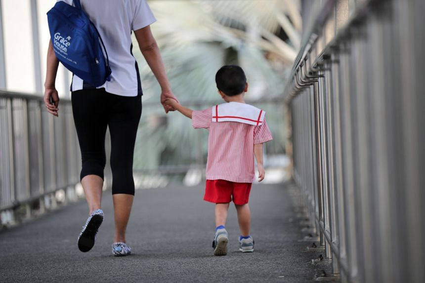 A parent walking their toddler to school on July 24, 2019.