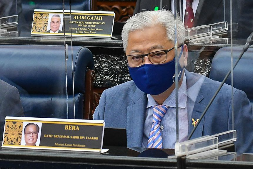 Malaysian Prime Minister Ismail Sabri Yaakob leads a fragile alliance of 114 MPs in the 222-seat Parliament.