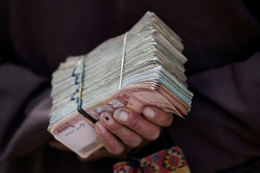 MoneyGram International said it was paying out in afghani only, without elaborating further.