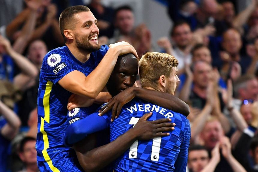 Chelsea's Romelu Lukaku celebrates scoring their third goal with teammates.