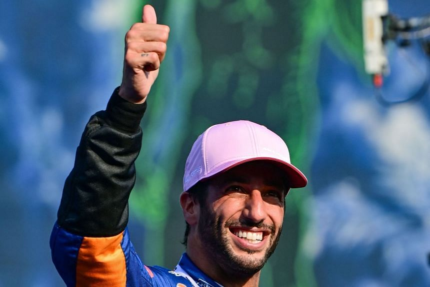 McLaren's Australian driver Daniel Ricciardo celebrates with his medal after placing third in the sprint session.