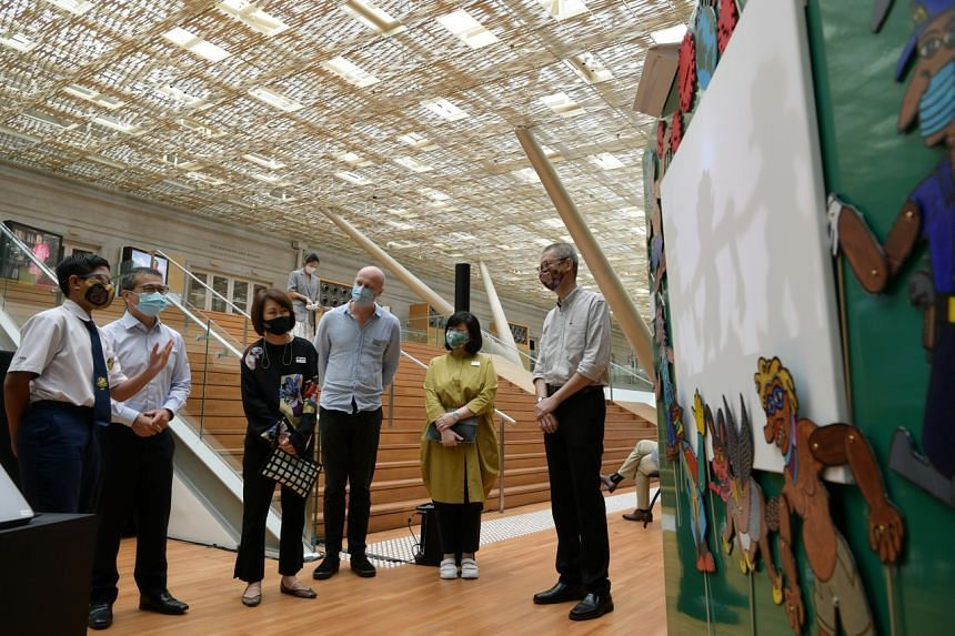 (From left) Student Muhammad Yassin and Minister for Culture, Community and Youth Edwin Tong at The Storyteller exhibition.