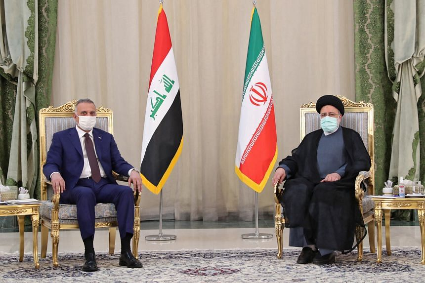 President Ebrahim Raisi (right) meeting with Iraqi Prime Minister Mustafa Al-Kadhemi in the capital Tehran on Sept 12, 2021.