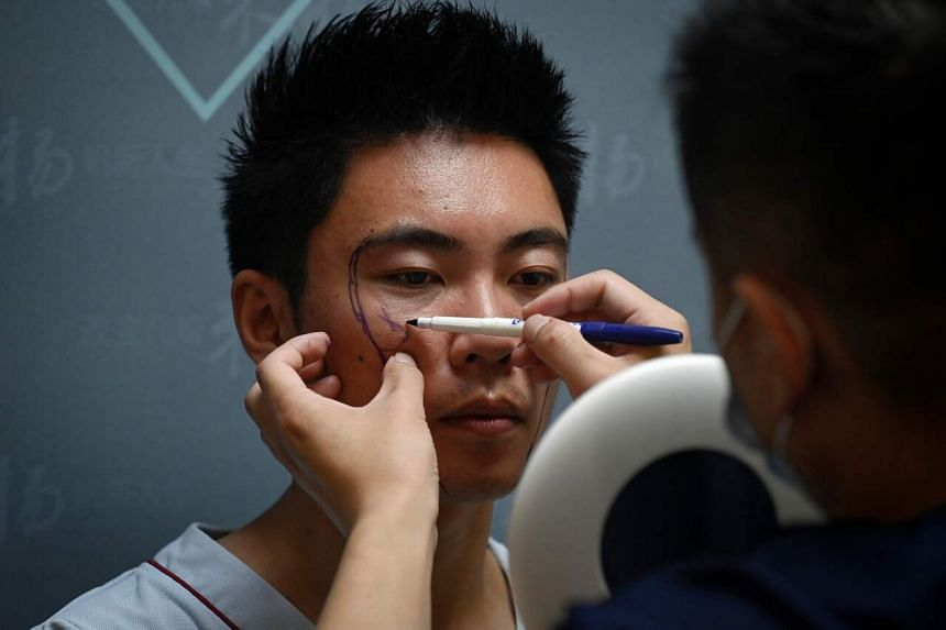 Growing numbers of educated men in China are opting for aesthetic and surgical procedures to give them the edge.